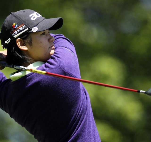 Yani Tseng, of Tawain, hits a tee shot on the sixth hole during a first round match against Jeong Jang, of South Korea, in the LPGA Sybase Match Play Championship.