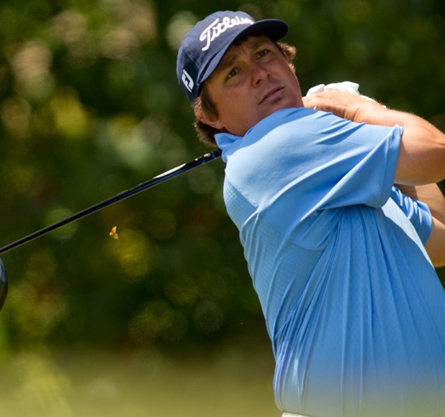 Jason Dufner plays a tee shot at the first hole during the final round of the HP Byron Nelson Championship at TPC Four Seasons Resort.