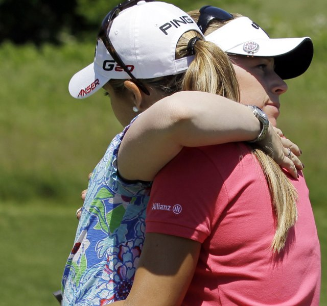 Morgan Pressel, left, and Azahara Munoz hug on the 17th hole green after Munoz won their semifinal round match in the LPGA Sybase Match Play Championship golf competition at Hamilton Farm Golf Club in Gladstone, N.J.
