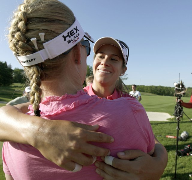 Azahara Munoz is congratulated by Morgan Pressel after Munoz beat Candie Kung in the championship match of the LPGA Sybase Match Play Championship.