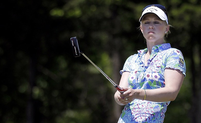 Morgan Pressel reacts after failing to sink a putt on the 17th hole during a semifinal round match against Azahara Munoz, of Spain, in the LPGA Sybase Match Play Championship.