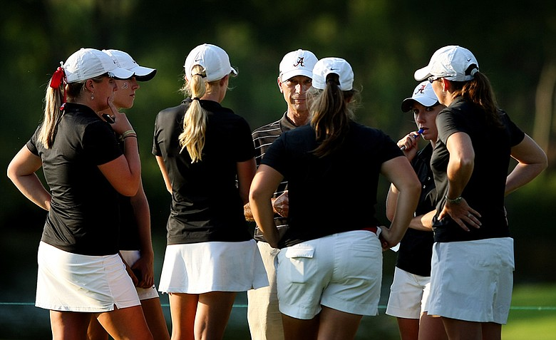 Alabama head coach, Mic Potter, center, talks with his players after their round on Thursday at the 2012 NCAA Division I Women's Golf Championships. Alabama began the day with an 11 shot lead that dwindled two 2.