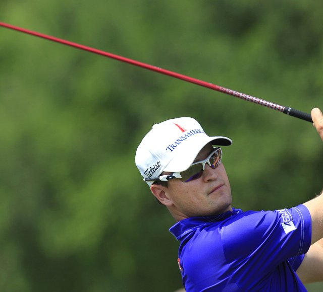 Zach Johnson watches his tee shot on the ninth hole during the first round of the Colonial golf tournament, Thursday, May 24, 2012, in Fort Worth, Texas.