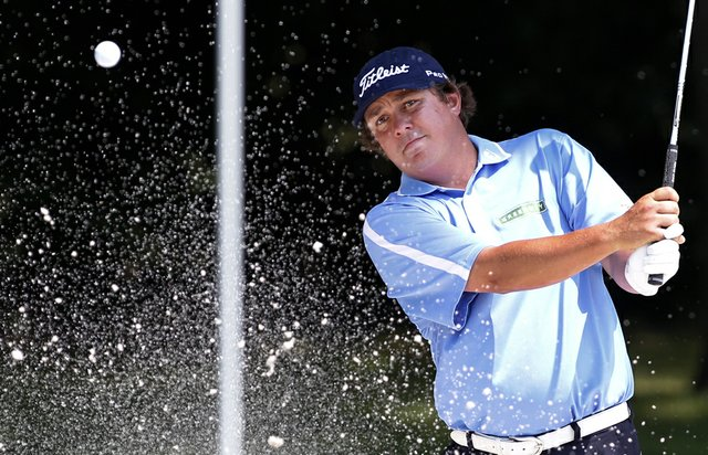 Jason Dufner hits out of a bunker onto the eighth green during the second round of the PGA Colonial golf tournament Friday, May 25, 2012, in Fort Worth, Texas.
