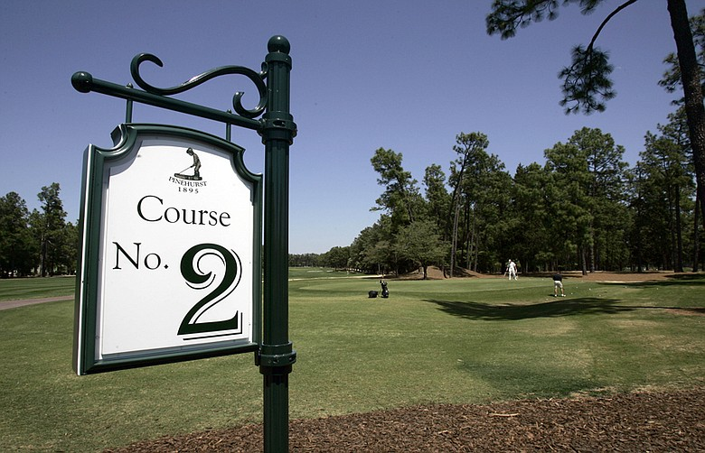 This April 23, 2007 file photo shows a sign identifying the Pinehurst No. 2 golf course at the Pinehurst Resort and Country Club in Pinehurst, N.C. In just over two years, Pinehurst's renowned No. 2 course will play host to the U.S. Open and U.S. Women's Open on consecutive weeks – the first time the USGA has attempted such a feat.