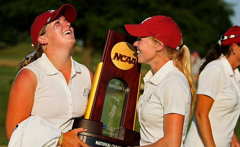 Alabama's Hannah Collier and Stephanie Meadow cradle the trophy after the 2012 NCAA Division I Women's Golf Championships. Collier, left, posted the low round of her team during the final round of the championship.