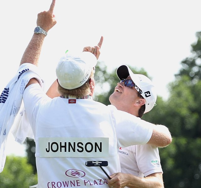 Zach Johnson celebrates on the 18th green with his caddie Damon Green after his one-stroke victory after the final round of the Crowne Plaza Invitational at Colonial at the Colonial Country Club. Green&#39;s father passed away last week.
