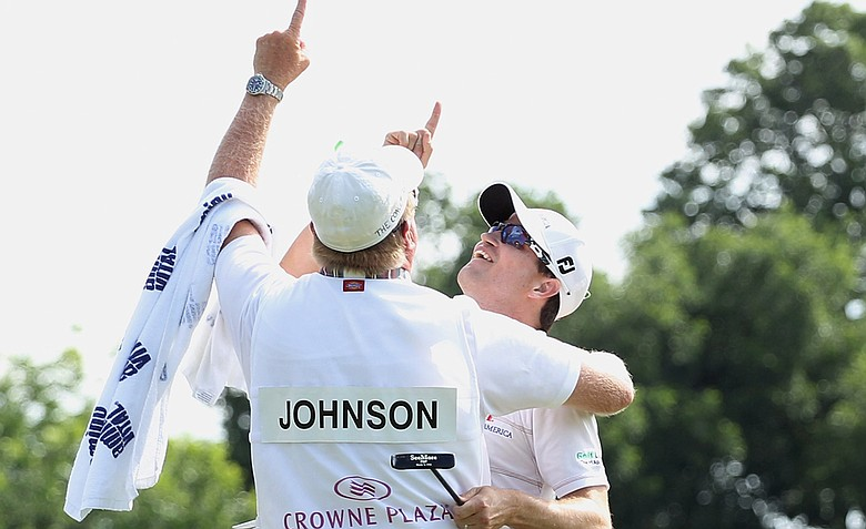Zach Johnson celebrates on the 18th green with his caddie Damon Green after his one-stroke victory after the final round of the Crowne Plaza Invitational at Colonial at the Colonial Country Club. Green's father passed away last week.