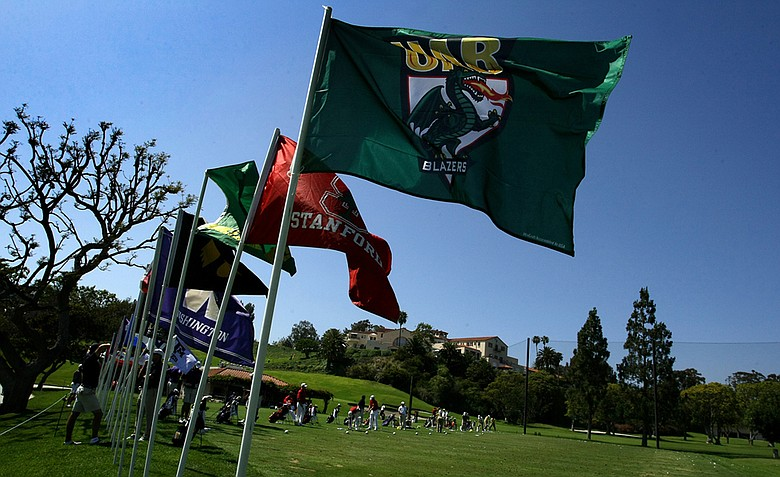College flags and the driving range during the 2012 NCAA Championship at Riviera Country Club in Pacific Palisades, Calif.