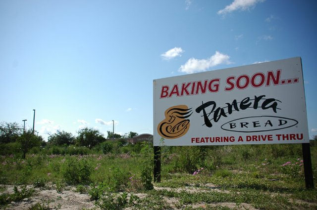 A sign along Mitchell Hammock Road in Oviedo tells passers by of a Panera Bread restaurant that's scheduled to open near the end of this year.