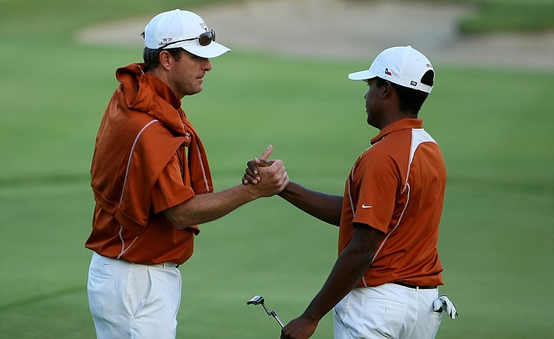 Assistant coach Jean-Paul Hebert with Julio Vegas during the final round of stroke play at the 2012 NCAA Championship. Texas advanced to match play.