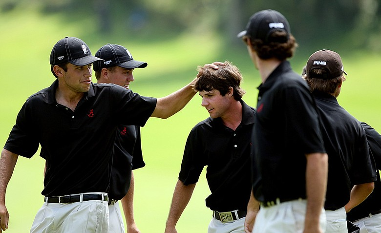 Alabama's Hunter Hamrick is mobbed by his teammates after clinching his match agains California's Joel Stalter during semifinals of Match Play at the 2012 NCAA Championship. Alabama will face Texas in the finals.