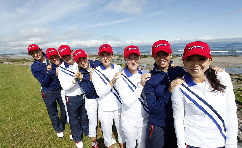 The U.S. Curtis Cup team huddles up during a practice round on tournament eve.