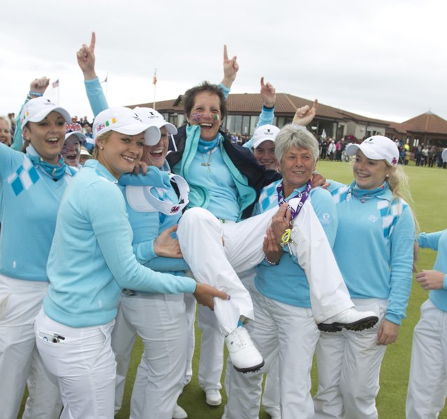 GB&I team lifted their captain Tegwin Matthews on the 18th green after its 10.5-9.5 victory in the Curtis Cup at The Nairn Golf Club in Nairn, Nairnshire, Scotland.