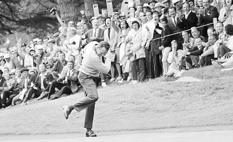Billy Casper reacts after he ran a 25-foot putt into the cup on the 11th green for a birdie 3 during his playoff with Arnold Palmer for the U.S. Open title in San Francisco, on June 20, 1966. Two strokes down at the time, Casper pulled even when Palmer bogeyed the hole.