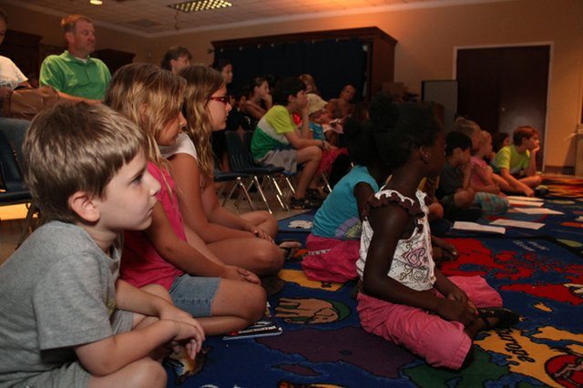 "Children watched a live show of ""Return to Wonderland"" at the Maitland Public Library."