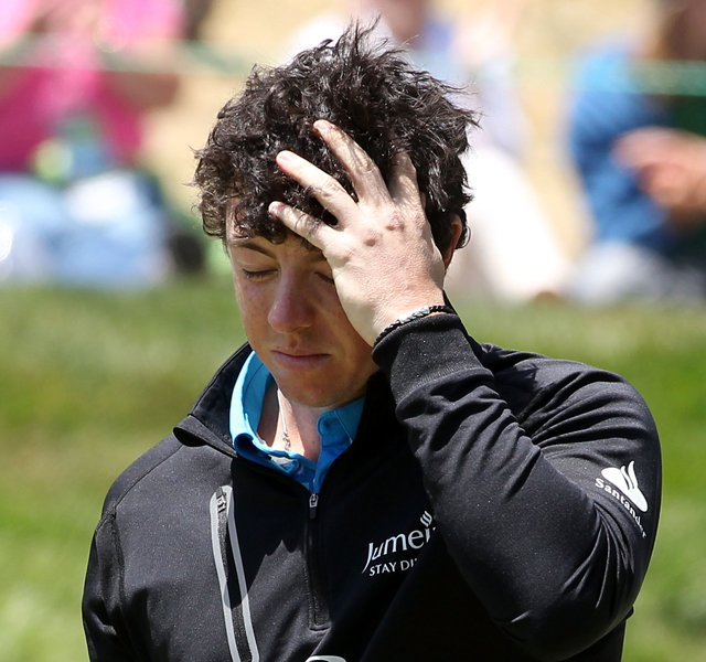 Rory McIlroy walks off the eighth green Friday after missing the cut in the 2012 U.S. Open.