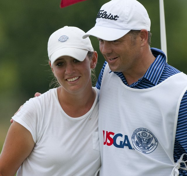 Ashlan Ramsey hugs her caddie after winning her match on the 18th hole as seen during the semifinal round of match play at the 2012 U.S. Women&#39;s Public Links at Neshanic Valley Golf Course.