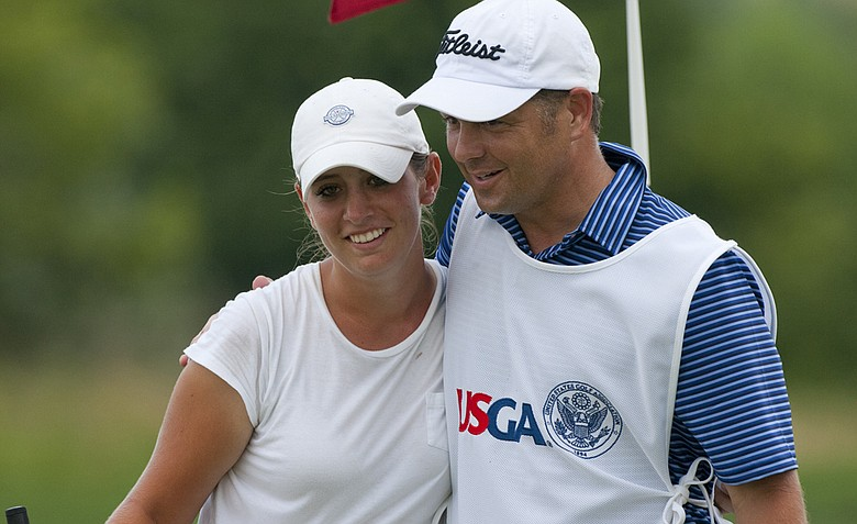 Ashlan Ramsey hugs her caddie after winning her match on the 18th hole as seen during the semifinal round of match play at the 2012 U.S. Women's Public Links at Neshanic Valley Golf Course.