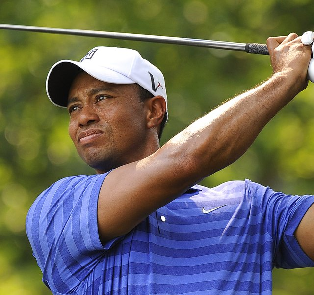 Tiger Woods hits a drive on the first hole during the second round of the AT&amp;T National at Congressional Country Club.