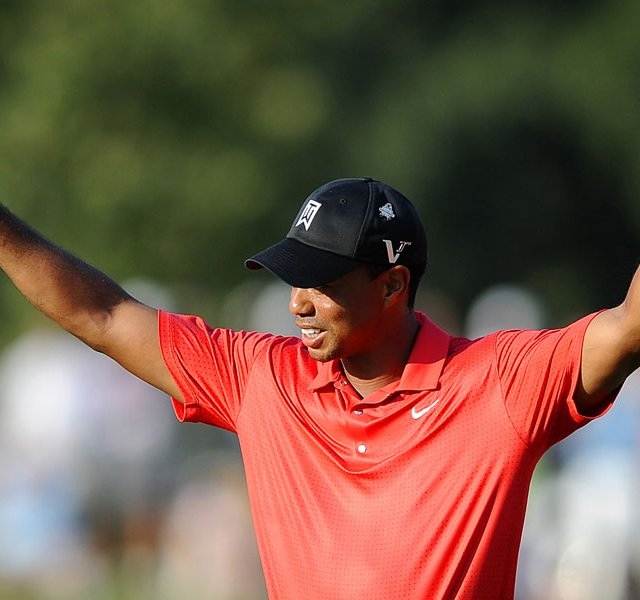 Tiger Woods reacts on the 18th green after winning the AT&amp;T National golf tournament at Congressional CC.