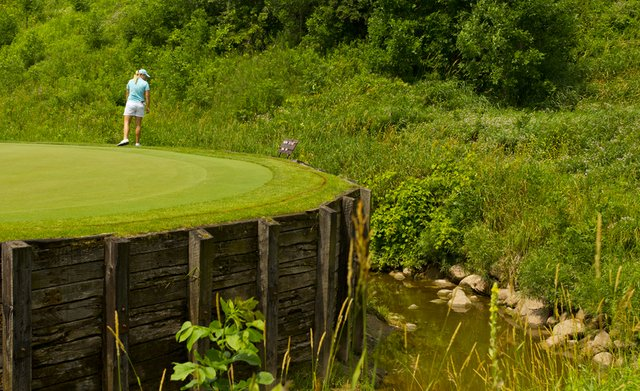 Brittany Lincicome looks over the edge of the fifth green during a practice round at the 2012 U.S. Women's Open at Blackwolf Run.