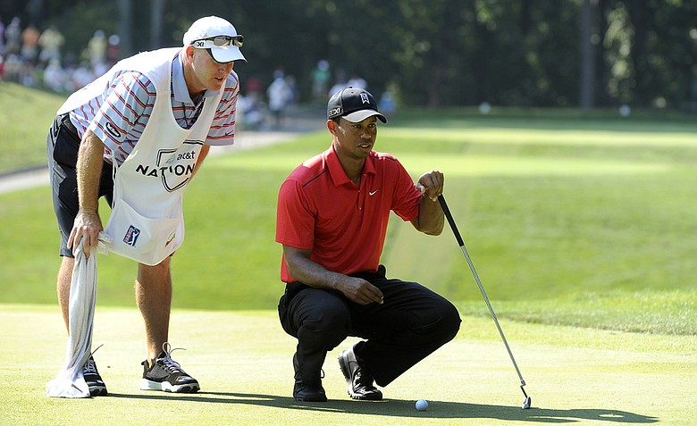 Joe LaCava, left, and Tiger Woods have teamed up for four wins thus far, including the Chevron World Challenge at the end of 2011.