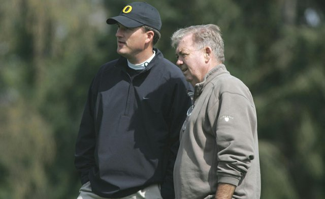 Former Oregon men's golf coach Steve Nosler, right, talks with current Ducks coach Casey Martin. Nosler died July 6, 2012 at the age of 74.