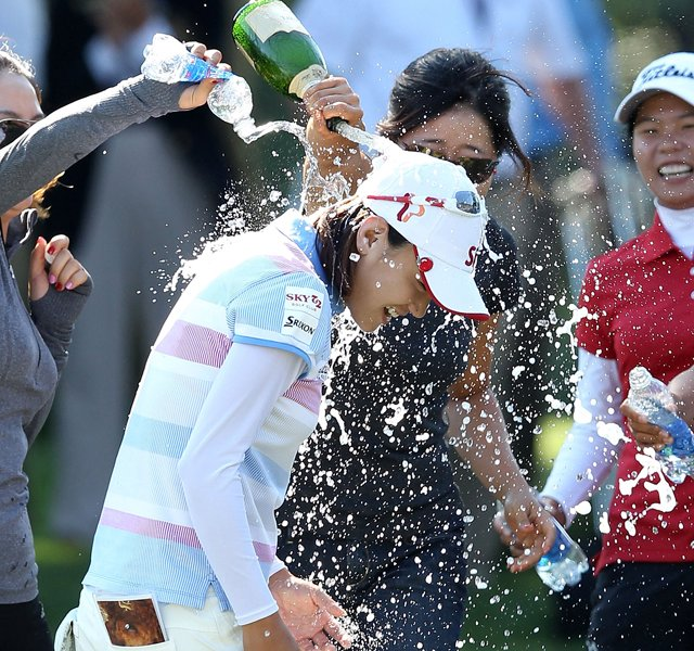 Na Yeon Choi is sprayed with champagne by players and friends after her four-stroke victory at the 2012 U.S. Women's Open.