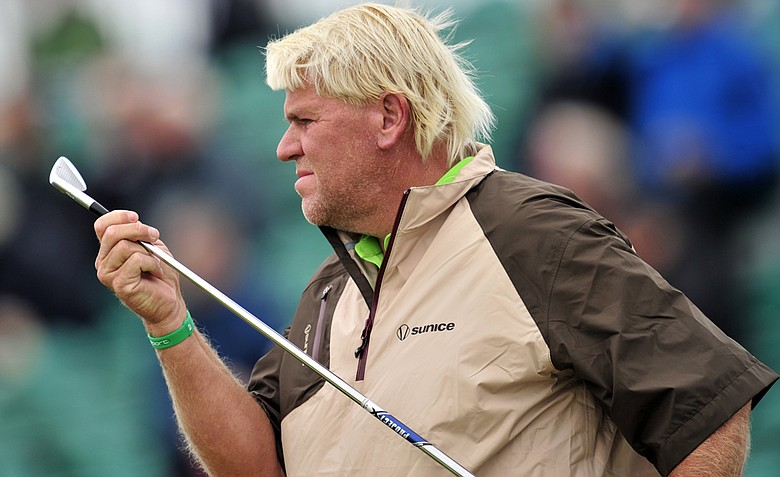 John Daly examines his club during a practice round for the 2012 Open Championship at Royal Lytham & St. Annes.