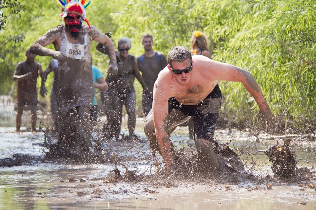 Sam Abbitt races through the mud.