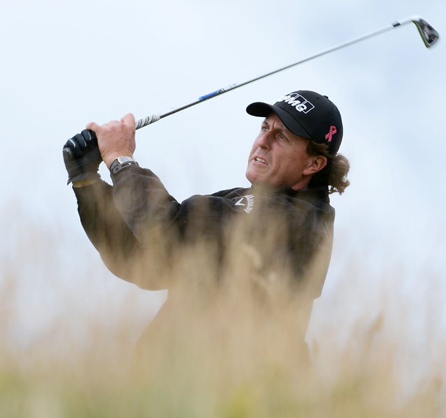 Phil Mickelson hits his tee shot on the 11th hole during the first round of the 141st Open Championship at Royal Lytham &amp; St. Annes Golf Club.