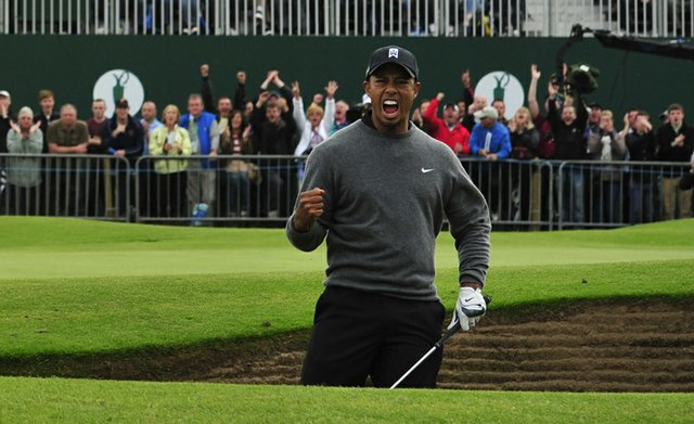 Tiger Woods celebrates holing his shot from a greenside bunker on the 18th hole during the second round of the 2012 Open Championship at Royal Lytham and St. Annes.