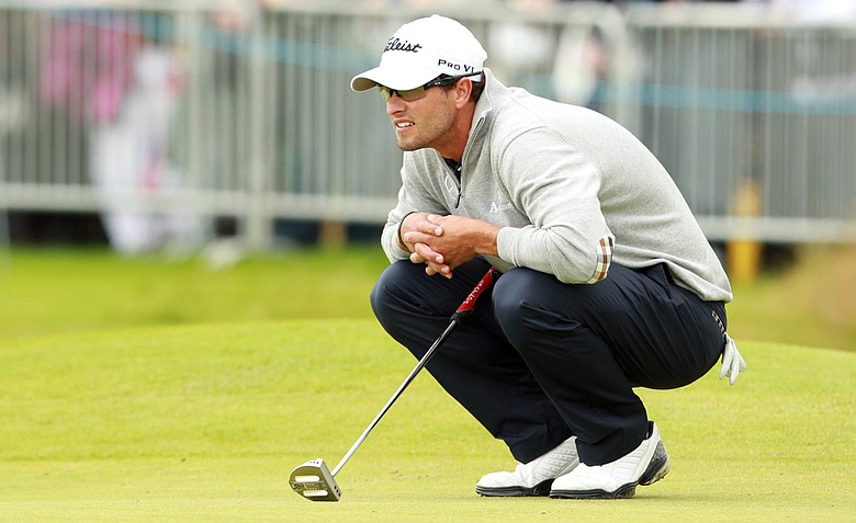 Adam Scott lines up his putt on the 1st green during the second round at the 2012 Open Championship at Royal Lytham and St. Annes.