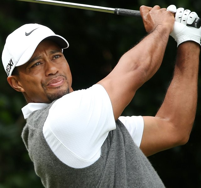 Tiger Woods watches his tee shot on the first hole during the third round of the 141st Open Championship at Royal Lytham & St. Annes Golf Club.