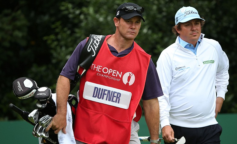 Jason Dufner walks with his caddie Gary Matthews during the third round of the 141st Open Championship at Royal Lytham & St. Annes Golf Club.
