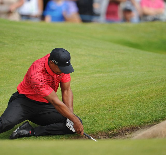 Tiger Woods watches a bunker shot on the sixth hole during the final round of the 141st Open Championship at Royal Lytham &amp; St. Annes Golf Club.