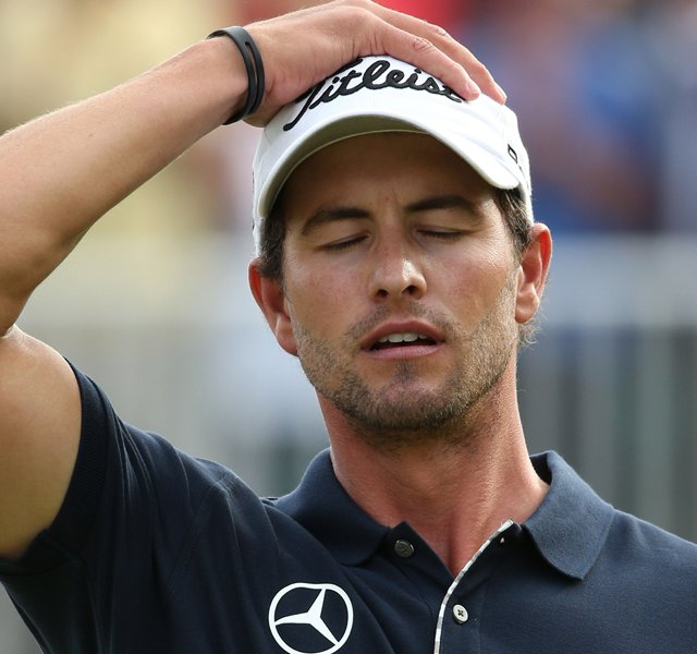 Adam Scott reacts to a missed par putt on the 18th green during the final round of the 141st Open Championship at Royal Lytham & St. Annes Golf Club.