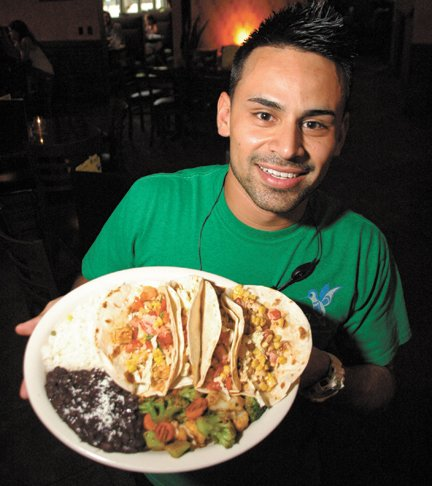 Manager Ricky Galicia shows off a dish of authentic Mexican tacos at Colibri in Baldwin Park.