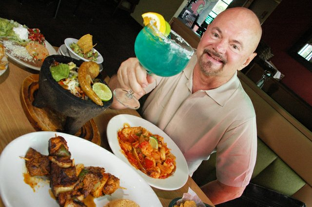 Voice food critic Josh Garrick shows off a made from scratch margarita from Señor Tequila in Winter Springs.