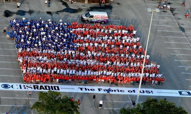"More than 800 Oviedo residents participated in waving the ""human"" flag to celebrate Independence Day."