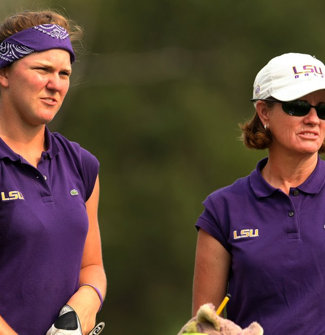 Austin Ernst (left), with LSU head coach Karen Bahnsen