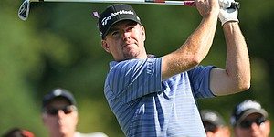 Garrigus sets record and takes lead in Canada