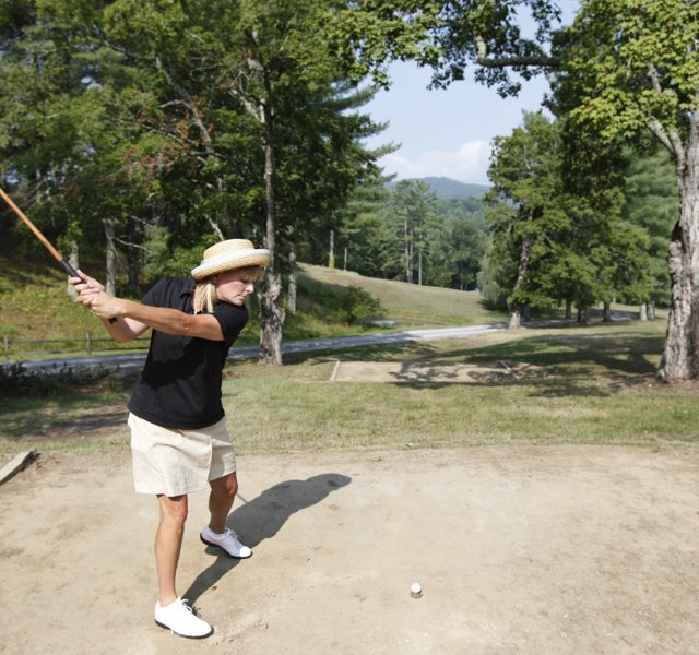 Jill Sharp takes a swing on the first tee at the Oakhurst Links golf course in White Sulphur Springs, W.Va.