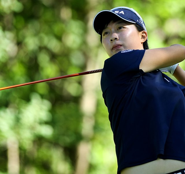 Hyo-Joo Kim watches her tee shot at No. 17 during the second round of stroke play at the 2012 U. S. Women&#39;s Amateur Championship at The Country Club in Cleveland. Kim posted a second consecutive 68.