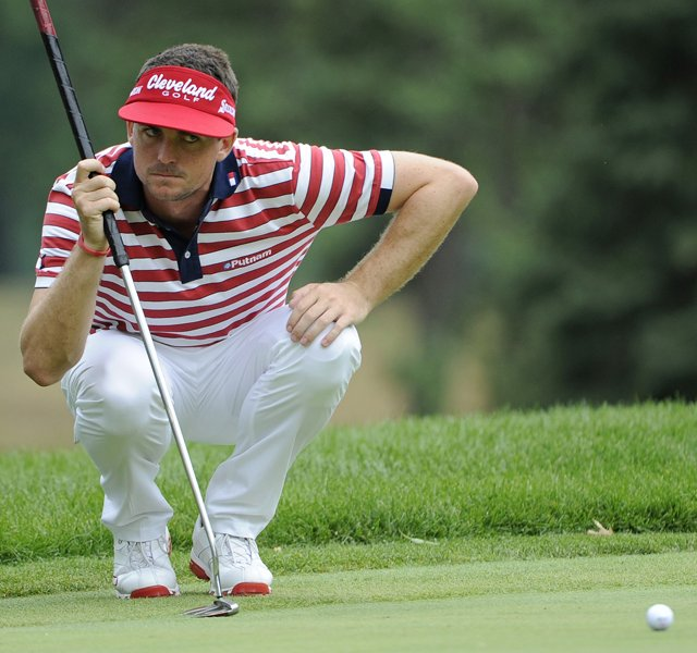 Keegan Bradley lines up a putt on the 4th green during the final round of the WGC-Bridgestone Invitational at Firestone Country Club with his Odyssey putter in hand.