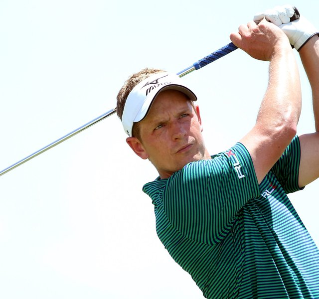 Luke Donald hits an iron shot during a practice round of the 2012 PGA Championship at the Ocean Course.