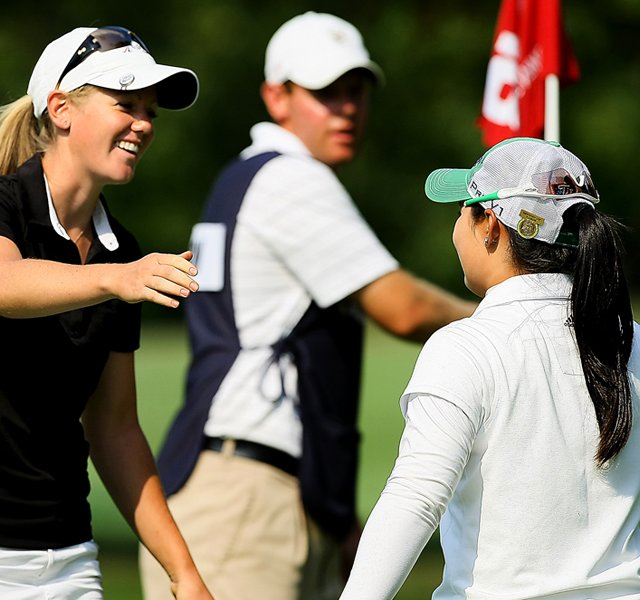 Amy Anderson hugs Moriya Jutanugarn after she won 1 up during the Round of 64 at the 112th U. S. Women's Amateur Championship. Jutanugarn was the runner-up at last year's Women's Am.