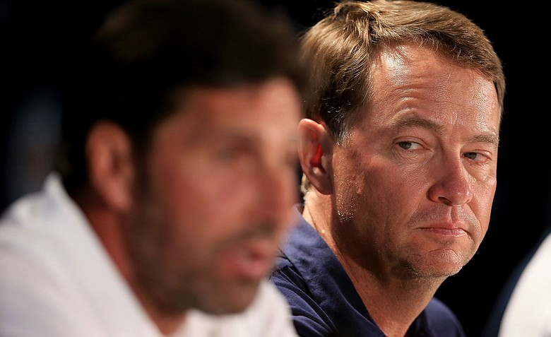 U.S. Ryder Cup captain Davis Love III looks on as European Ryder Cup captain Jose Maria Olazabal speaks during a practice round of the 94th PGA Championship at the Ocean Course.