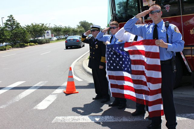 Oviedo firefighters salute the funeral procession of fallen soldier Pfc. Brenden Salazar of Chuluota Aug. 3.